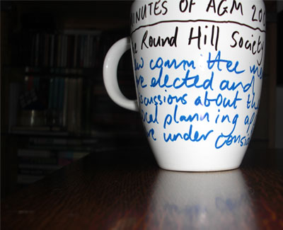 AGM minutes written on tea cup